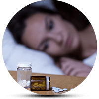 pills near bed of a woman
