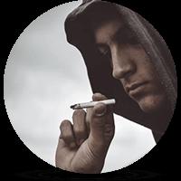 young man smoking marijuana