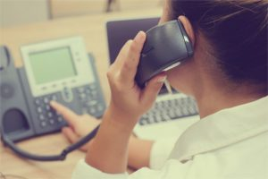 close up hotline call centre woman work as operator and try to response answer's customer question or partner concept