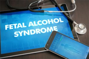 Fetal alcohol syndrome (congenital disorder) diagnosis medical concept on tablet screen with stethoscope