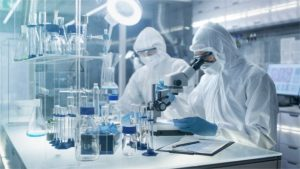 In a Secure High Level Laboratory Scientists in a Coverall Conducting a Research