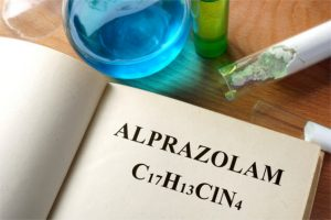 Book with Alprazolam and test tubes