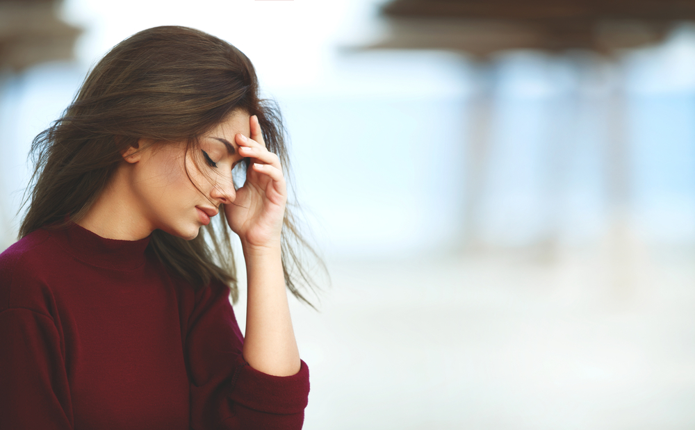 Young woman stressed because of addiction signs