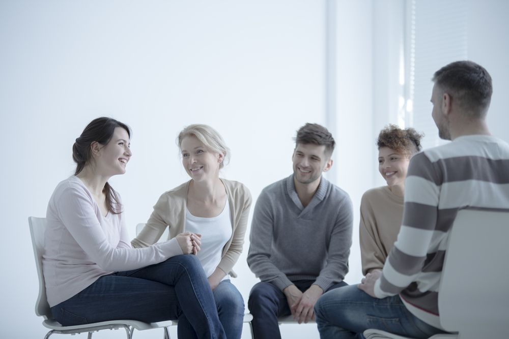 A group of patients attend therapy together in rehab.