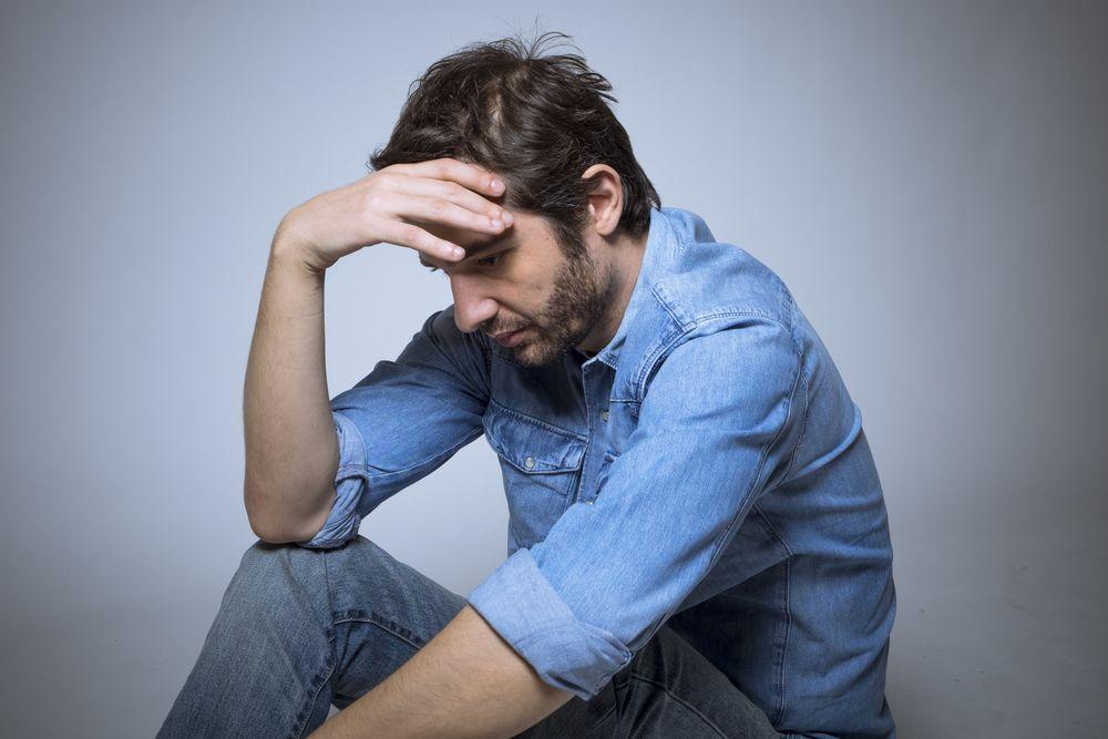 Depressed man suffering from barbiturates addiction