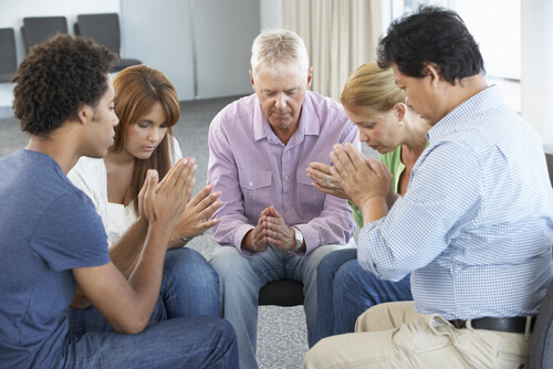 People praying to get rid of addictions