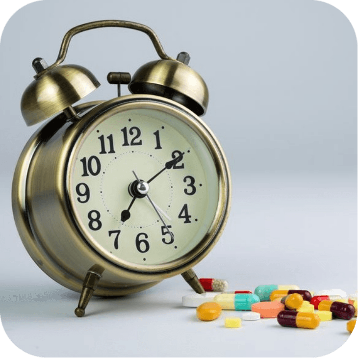 Clock next to valium pills showing time of action.