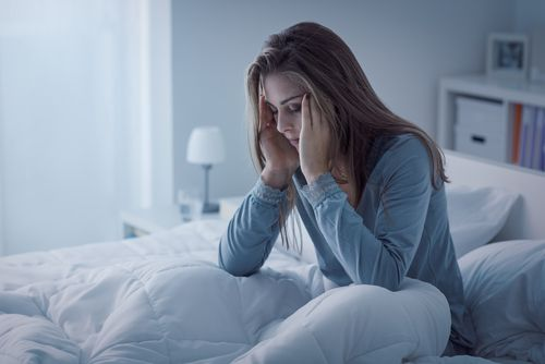 Depressed woman awake in the night.