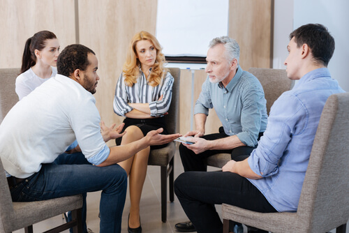 family having a discussion during therapy