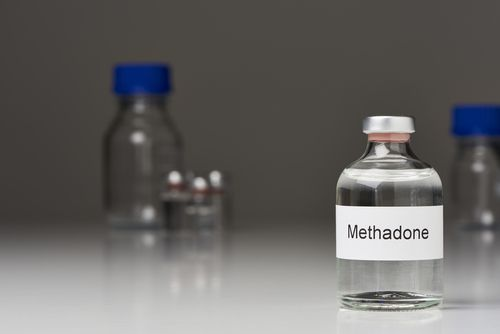 Bottle at forefront with Methadone written on it.