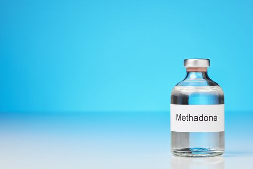 Bottle of Methadone on a white surface