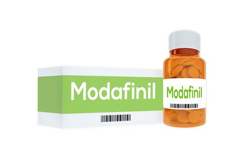 A bottle of Modafinil pills with Modafinil written by the side of it.