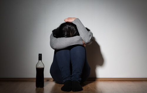 Woman struggling with alcoholism