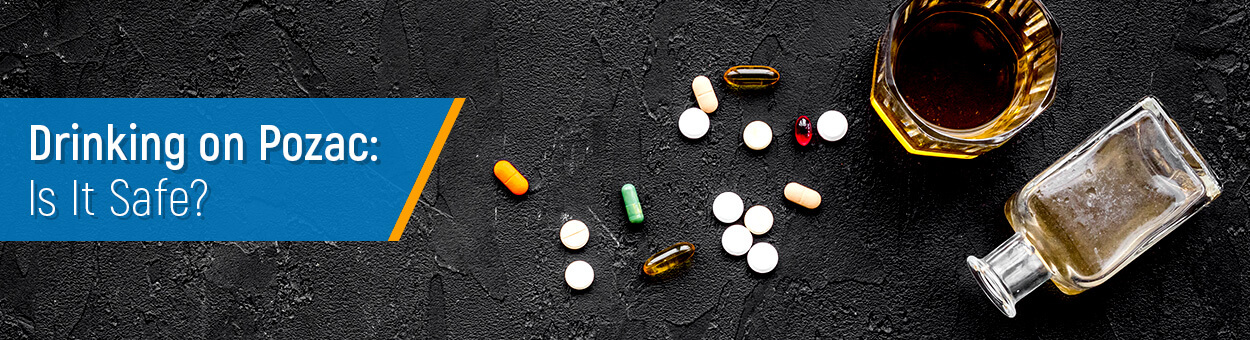 pills and glass of alcoholic drink on the table