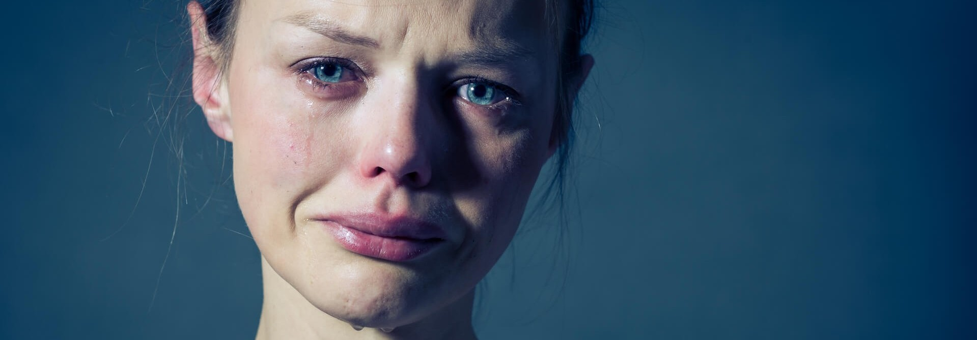 young woman in tears