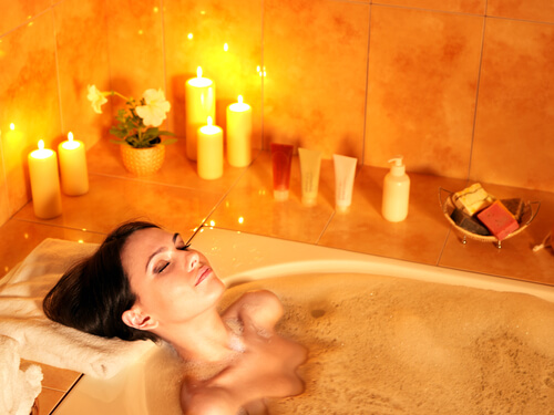 woman relaxed in hot bubble bath