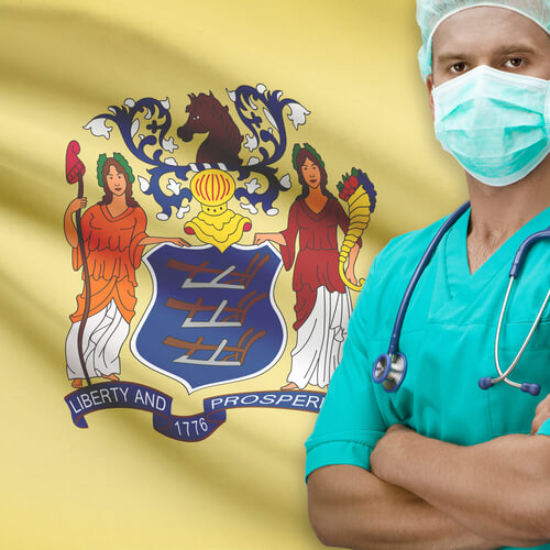 doctor in uniform standing near the New Jersey flag