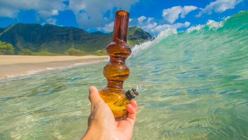 bong for marijuana smoking woth ocean on the background