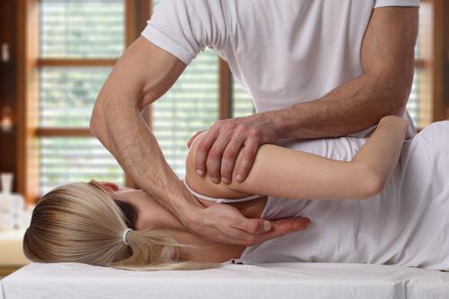 chiropractor healing woman's back