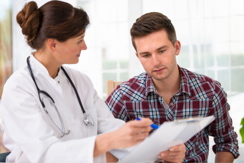 female doctor consulting a young man patient