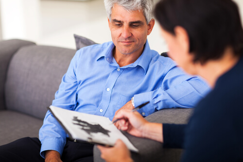 middle age man on a provate session with therapist