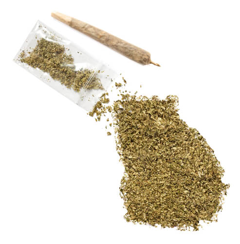 marijuana laying on the table in shape of Georgia state and a joint