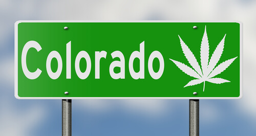 Colorado road sign with marijuana leaves printed on it