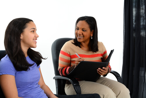 teenage girl on a consultation with therapist