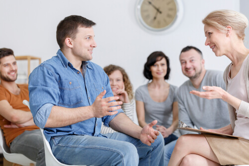 group meeting with therapist on 12-step program