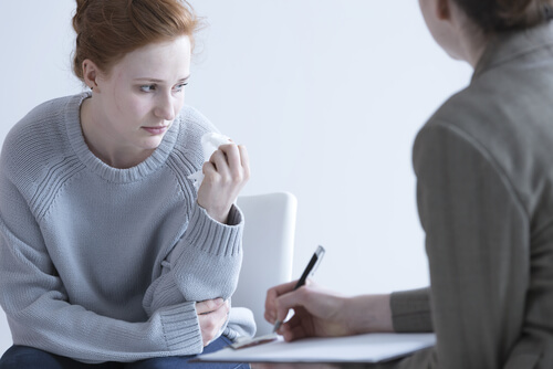 young woman on personal consultation with therapist