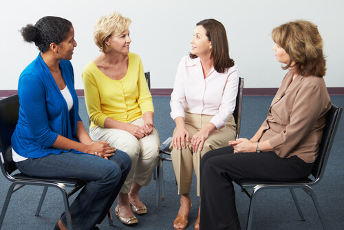 four women in a circle sitting at the women support group meeting