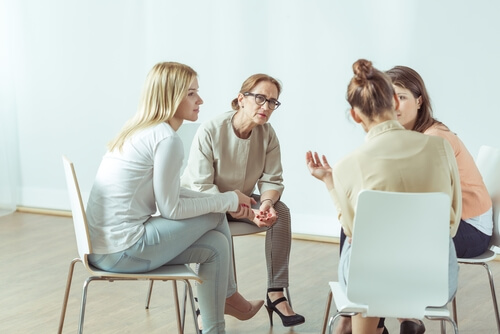 four women sitting in a cicrle on a support group meeting