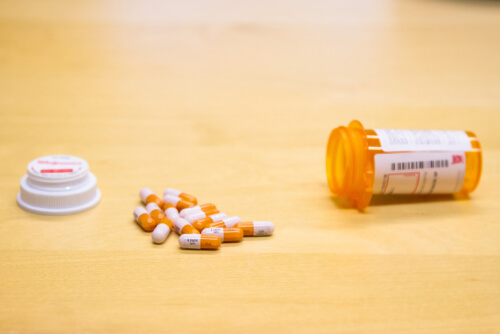 Adderall pills and bottle lying on the table