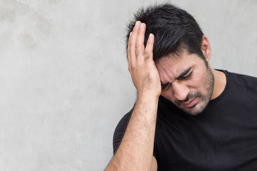 man suffering with severe withdrawal headache