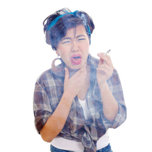 smoking woman surrounded by smoke and coughing badly