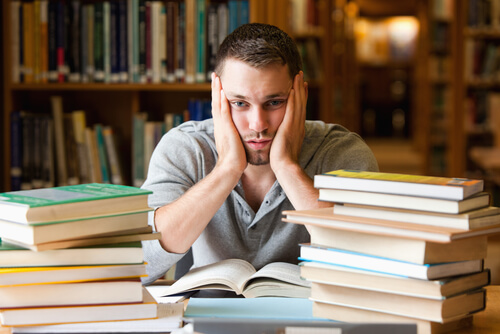 college students sitiing at books unable to focus and concentrate