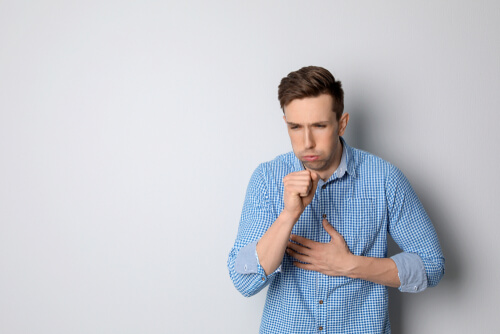 man with cough and breathing problems