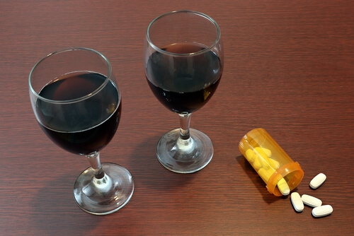 wine glasses and bottle with prescription hydrocodone