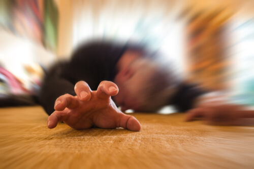 man lying on the floor with seizures