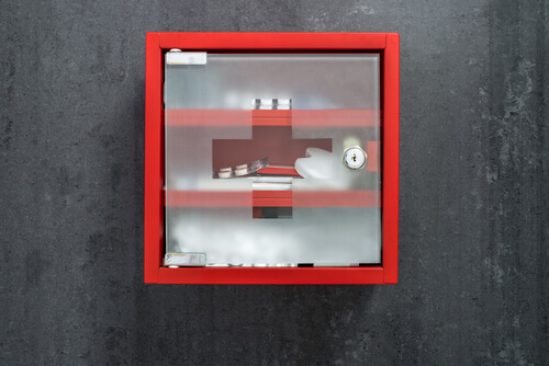 red medicinal cabinet with prescription pills on the wall