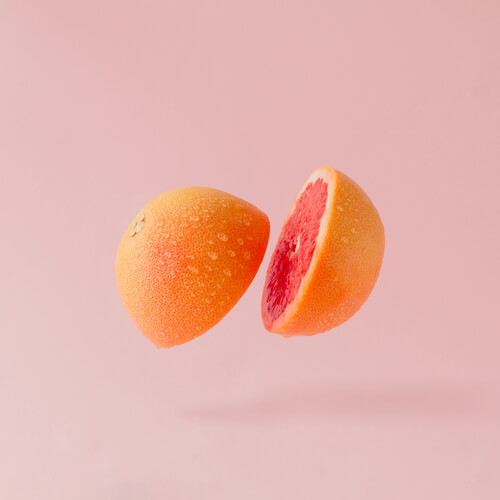 grapefruit sliced on a pastel background