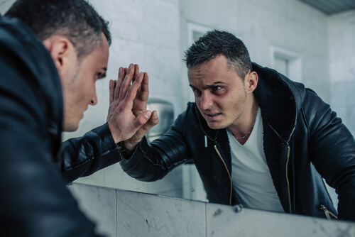 heroin addict looking at the mirror in office bathroom high on heroin