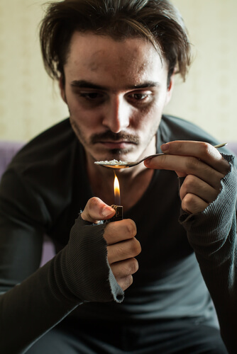 heroin addict prepares the drug for intake