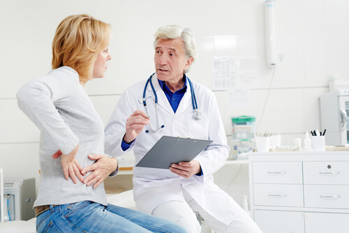 mature doctor giving recommendations to his patient