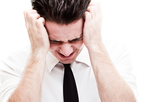 man having a headache and vertigo