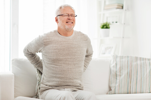senior man suffering from pain in back