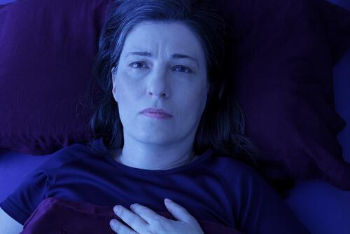 woman lying awake in her bed
