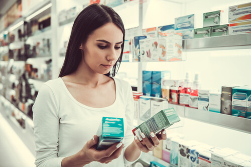 young woman is choosing a medication