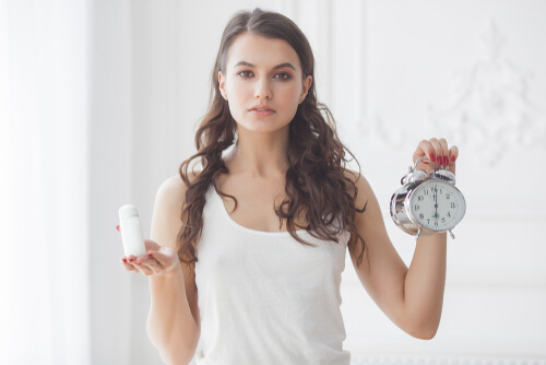 young woman taking pills at right time