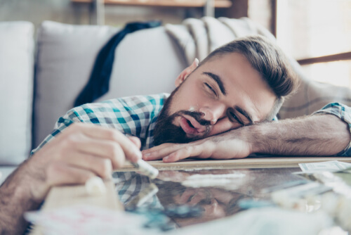 man lying on the table feeling high